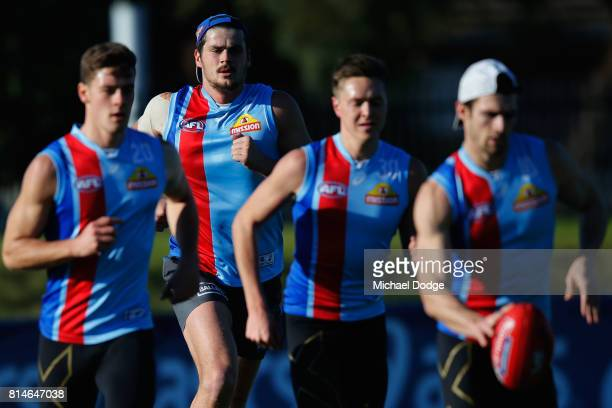 Tom Boyd, recovering from clinical depression, is well behind Easton Wood as he runs with during a Western Bulldogs AFL training session at Whitten...