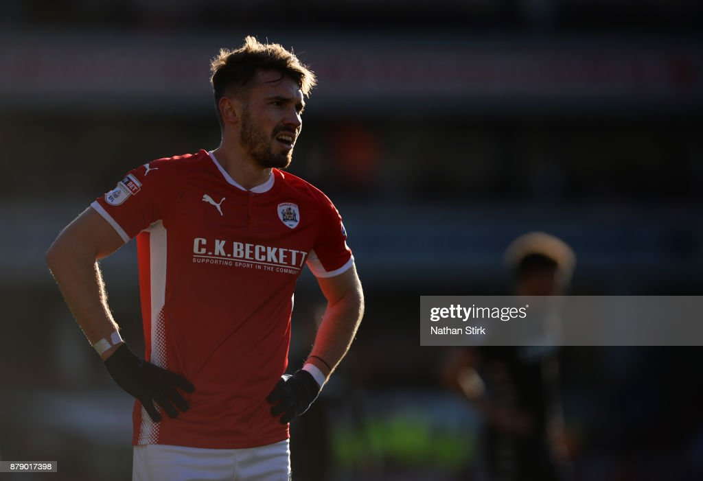 Tom Bradshaw of Barnsley looks on during the Sky Bet Championship match between Barnsley and Leeds United at Oakwell Stadium on November 25, 2017 in Barnsley, England.