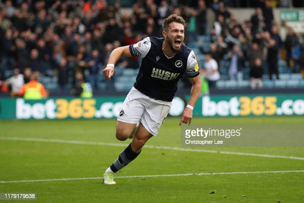 Tom Bradshaw of Millwall celebrates scoring their second goal during the Sky Bet Championship match between Millwall and Leeds United at The Den on...
