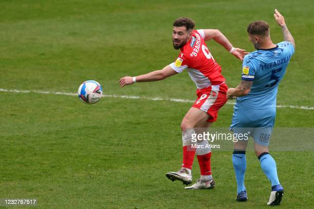 Tom Bradshaw of Millwall in action with Kyle McFadzean of Coventry City during the Sky Bet Championship match between Coventry City and Millwall at...