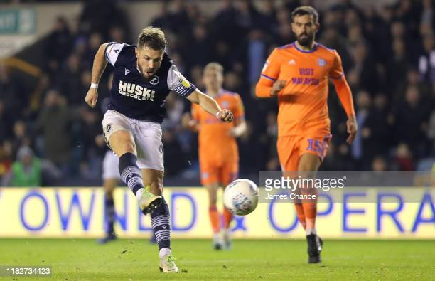 Tom Bradshaw of Millwall scores his team's second goal during the Sky Bet Championship match between Millwall FC and Cardiff City at The Den on...