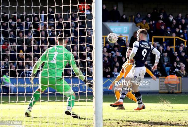 Tom Bradshaw of Millwall scores his team's third goal during the FA Cup Third Round match between Millwall FC and Newport County AFC at The Den on...
