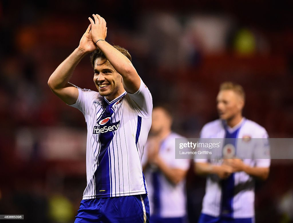 Tom Bradshaw of Walsall applauds the fans after the Capital One Cup First Round match between Nottingham Forest and Walsall at City Ground on August 11, 2015 in Nottingham, England.