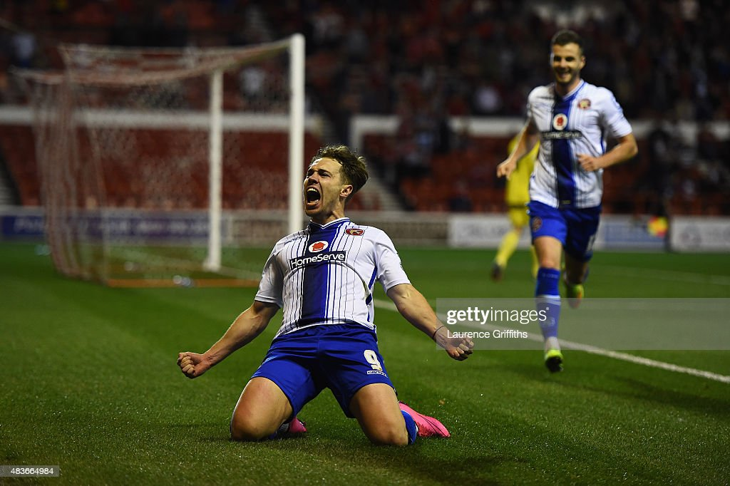 Tom Bradshaw of Walsall celebrates scoring the winning goal during the Capital One Cup First Round match between Nottingham Forest and Walsall at City Ground on August 11, 2015 in Nottingham, England.