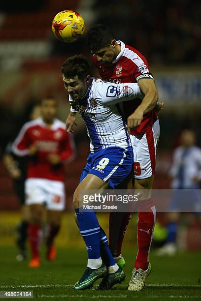 Tom Bradshaw of Walsall is challenged by Raphael Rossi-Branco of Swindon Townduring the Sky Bet League One match between Swindon Town and Walsall at...
