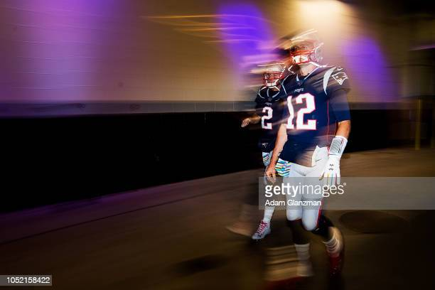 Tom Brady and Brian Hoyer of the New England Patriots walk through the tunnel towards the field before a game against the Kansas City Chiefs at...