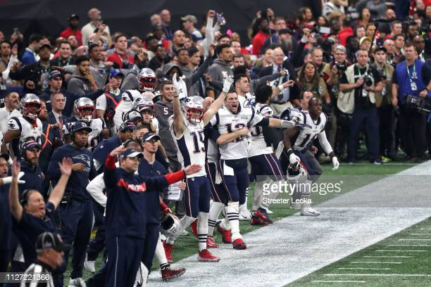 Tom Brady and Chris Hogan of the New England Patriots celebrate a missed field goal late in the fourth quarter against the Los Angeles Ramsduring...