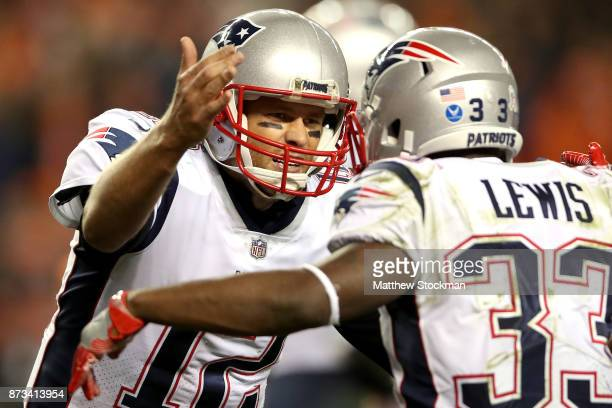 Tom Brady and Dion Lewis of the Neew England Patriots celebrate a touchdown against the Denver Broncos at Sports Authority Field at Mile High on...