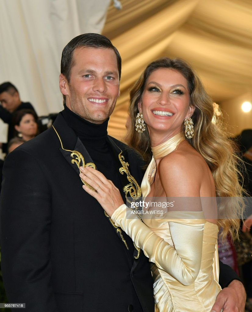 Tom Brady (L) and Gisele Bundchen arrive for the 2018 Met Gala on May 7, 2018, at the Metropolitan Museum of Art in New York. (Photo by Angela WEISS / AFP) / The erroneous mention[s] appearing in the metadata of this photo by Angela WEISS has been modified in AFP systems in the following manner: [Gisele Bundchen] instead of [Gisele Brundchen]. Please immediately remove the erroneous mention[s] from all your online services and delete it (them) from your servers. If you have been authorized by AFP to distribute it (them) to third parties, please ensure that the same actions are carried out by them. Failure to promptly comply with these instructions will entail liability on your part for any continued or post notification usage. Therefore we thank you very much for all your attention and prompt action. We are sorry for the inconvenience this notification may cause and remain at your disposal for any further information you may require.
