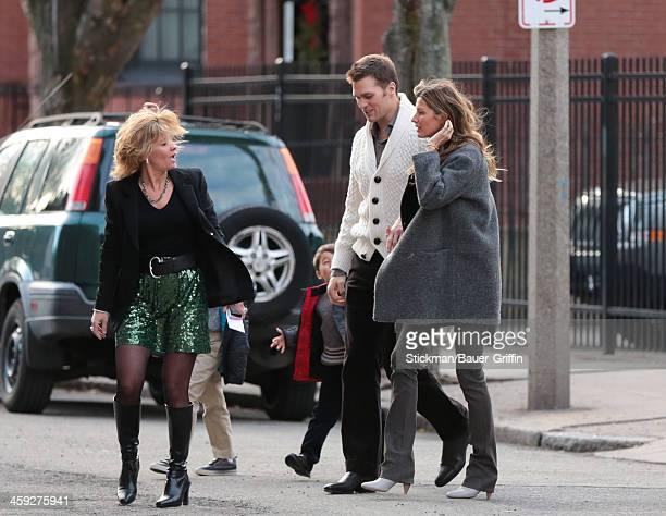 Tom Brady and Gisele Bundchen with sons John Moynahan and Benjamin Brady are seen on December 24 2013 in Boston Massachusetts