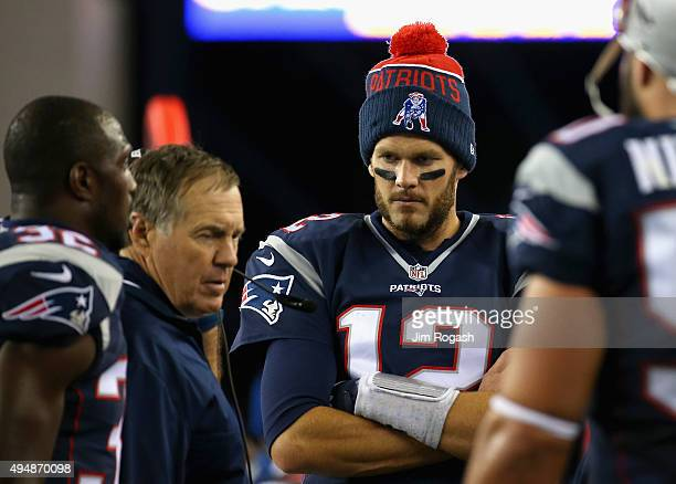 Tom Brady and head coach Bill Belichick of the New England Patriots reacts during the fourth quarter against the Miami Dolphins at Gillette Stadium...