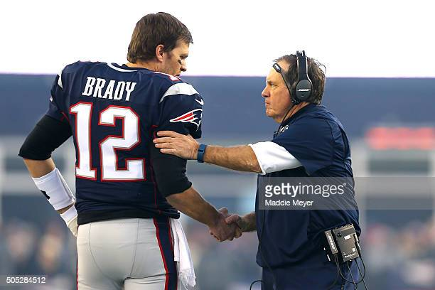 Tom Brady and head coach Bill Belichick of the New England Patriots shake hands at the start of the AFC Divisional Playoff Game against the Kansas...