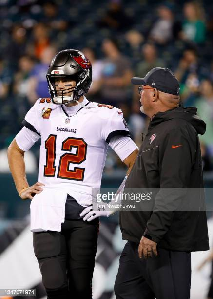 Tom Brady and head coach Bruce Arians of the Tampa Bay Buccaneers speak before a game against the Philadelphia Eagles at Lincoln Financial Field on...