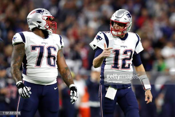 Tom Brady and Isaiah Wynn of the New England Patriots react against the Houston Texans during the first quarter in the game at NRG Stadium on...