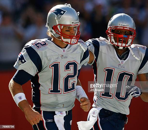 Tom Brady and Jabar Gaffney of the New England Patriots celebrate a touchdown during a game against the Buffalo Bills at Gillette Stadium September...