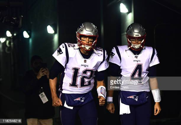 Tom Brady and Jarrett Stidham of the New England Patriots run out of the tunnel for warm ups prior to their game against the New York Jets at MetLife...