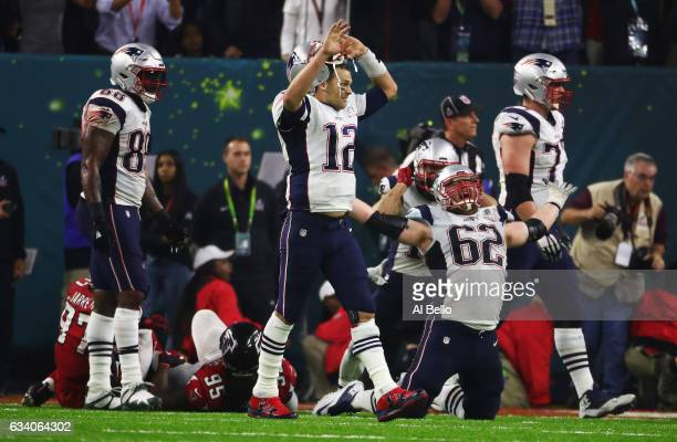 Tom Brady and Joe Thuney of the New England Patriots celebrate a 3428 overtime win against the Atlanta Falcons during Super Bowl 51 at NRG Stadium on...