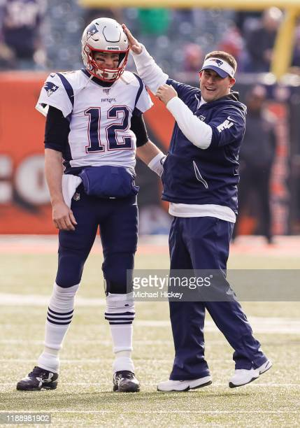 Tom Brady and Josh McDaniels offensive coordinator for the New England Patriots talk before the game against the Cincinnati Bengals at Paul Brown...