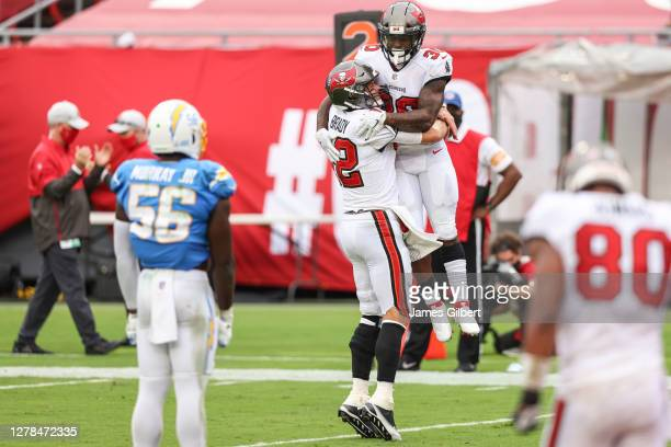 Tom Brady and Ke'Shawn Vaughn of the Tampa Bay Buccaneers celebrate after scoring a touchdown during the fourth quarter of a game against the Los...