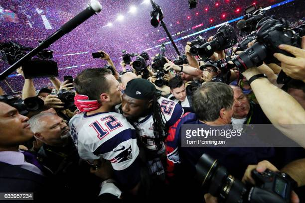 Tom Brady and LeGarrette Blount of the New England Patriots celebrate after defeating the Atlanta Falcons 3428 during Super Bowl 51 at NRG Stadium on...
