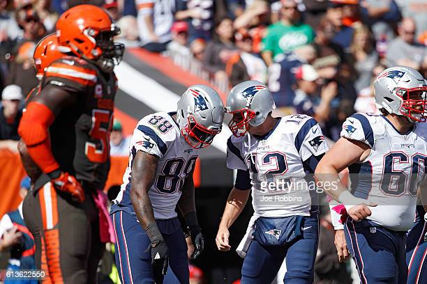 Tom Brady and Martellus Bennett of the New England Patriots celebrate after a fiveyard touchdown reception in the second quarter of the game against...