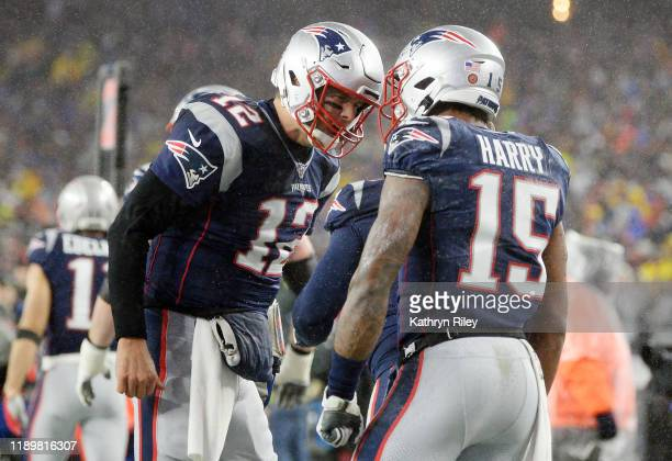 Tom Brady and N'Keal Harry of the New England Patriots celebrate after scoring a touchdown during the first quarter against the Dallas Cowboys in the...