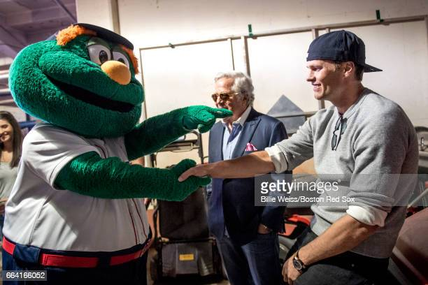 Tom Brady and owner Robert Kraft of the New England Patriots are greeted by Boston Red Sox mascot Wally before a pregame ceremony before the Boston...