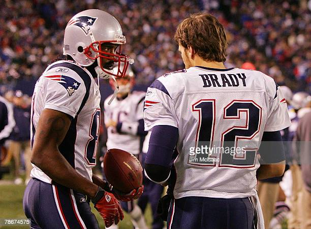 Tom Brady and Randy Moss of the New England Patriots talk on the sidelines during a game against the New York Giants on December 29 2007 at Giants...