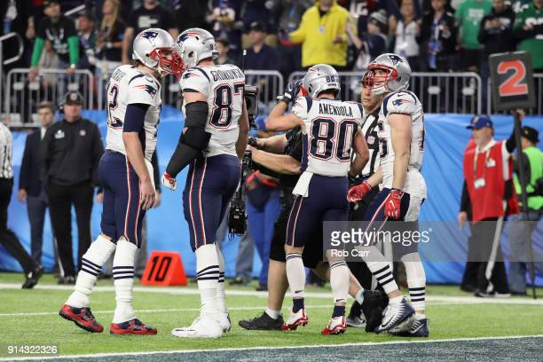 Tom Brady and Rob Gronkowski of the New England Patriots celebrate their third quarter touchdown pass against the Philadelphia Eagles in Super Bowl...