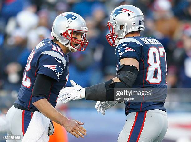 Tom Brady and Rob Gronkowski of the New England Patriots react after Gronkowski caught a touchdown pass during the third quarter against the Miami...