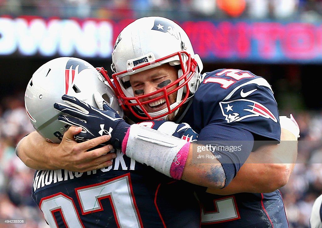 Tom Brady #12 and Rob Gronkowski #87 of the New England Patriots react after Gronkowski scored a touchdown during the fourth quarter against the New York Jets at Gillette Stadium on October 25, 2015 in Foxboro, Massachusetts.