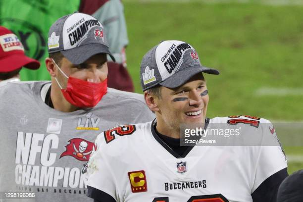 Tom Brady and Rob Gronkowski of the Tampa Bay Buccaneers celebrate their 31 to 26 win over the Green Bay Packers during the NFC Championship game at...