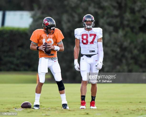 Tom Brady and Rob Gronkowski of the Tampa Bay Buccaneers warm up during training camp at AdventHealth Training Center on August 20, 2020 in Tampa,...