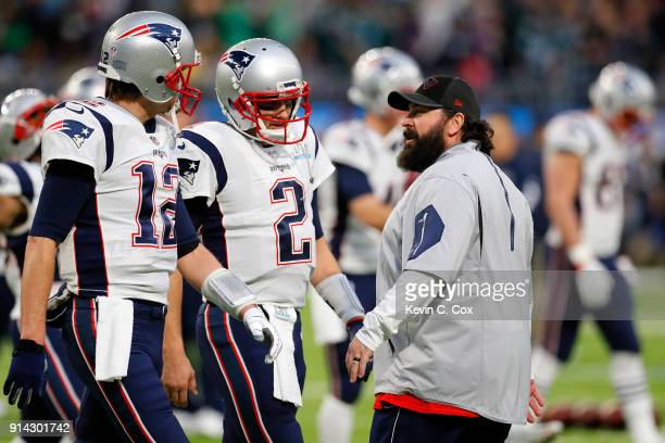 Tom Brady Brian Hoyer of the New England Patriots and defensive coordinator Matt Patricia talk during warmups prior to Super Bowl LII against the...