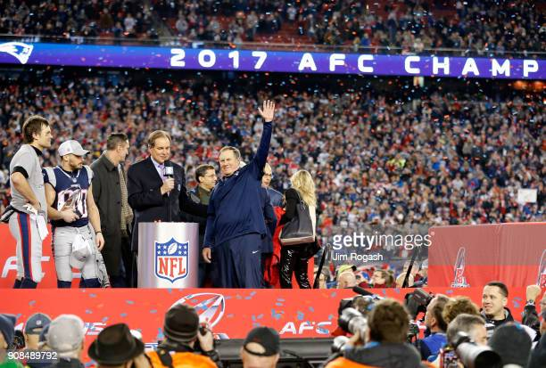Tom Brady Danny Amendola and head coach Bill Belichick of the New England Patriots celebrate with the Lamar Hunt trophy as they are interviewed by...