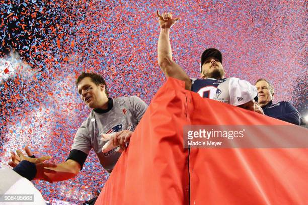 Tom Brady Danny Amendola and head coach Bill Belichick of the New England Patriots celebrate after winning the AFC Championship Game against the...