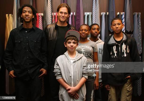 Tom Brady greets Boys and Girls Club members Banieo Canngieper Andrew Selaghlin Nyjaisha Washiappon Isaiah Milton and Nelson Castillo at Ermenegildo...