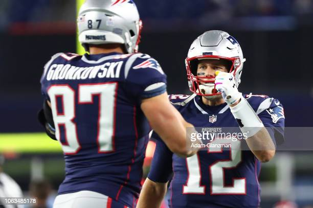 Tom Brady high fives Rob Gronkowski of the New England Patriots before a game against the Kansas City Chiefs at Gillette Stadium on October 14 2018...