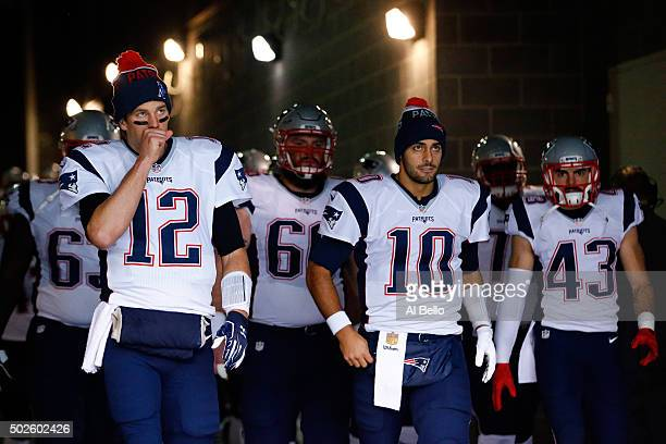 Tom Brady Jimmy Garoppolo and Nate Ebner of the New England Patriots prepare to take the field prior to their game against the New York Jets at...