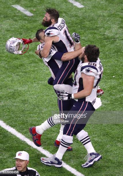 Tom Brady Julian Edelman and David Andrews of the New England Patriots celebrate after defeating the Atlanta Falcons during Super Bowl 51 at NRG...
