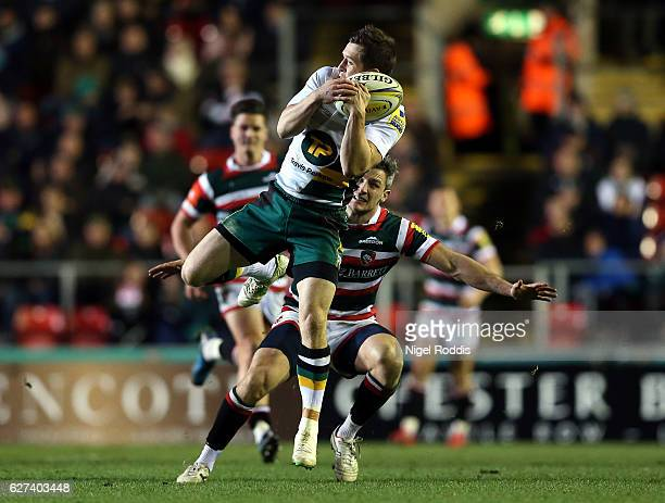 Tom Brady of Leicester Tigers challenges Jamie Elliott of Northampton Saints during the Aviva Premiership match between Leicester Tigers and...