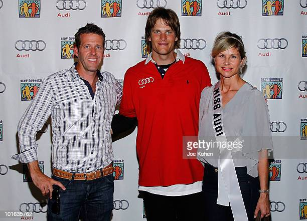 Tom Brady of New England Patriots poses for a photo with Michael Patrick VIP and Media manager Audi of America and Anja Kaehny East Coast Media...