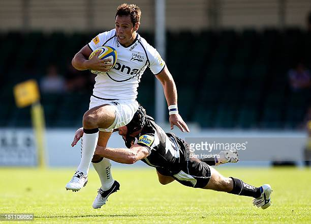 Tom Brady of Sale runs through the tackle of Tom Johnson of Exeter during the Aviva Premiership match between Exeter Chiefs and Sale Sharks at the...