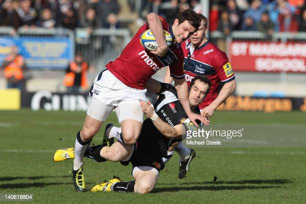 Tom Brady of Sale Sharks is held up by Haydn Thomas of Exeter during the Aviva Premiership match between Exeter Chiefs and Sale Sharks at Sandy Park...