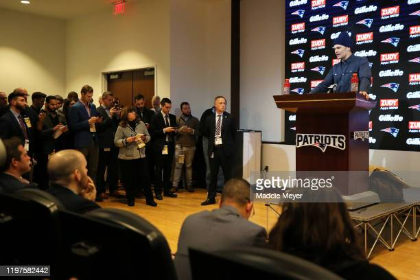 Tom Brady of the New England Patriots addresses the media during a press conference following the Patriots 2013 loss in the AFC Wild Card Playoff...
