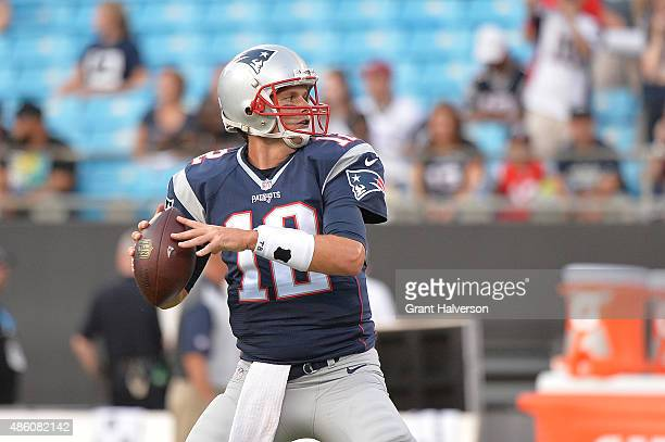 Tom Brady of the New England Patriots against the Carolina Panthers during their preseason NFL game at Bank of America Stadium on August 28 2015 in...