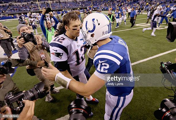 Tom Brady of the New England Patriots and Andrew Luck of the Indianapolis Colts meet after the game at Lucas Oil Stadium on November 16 2014 in...
