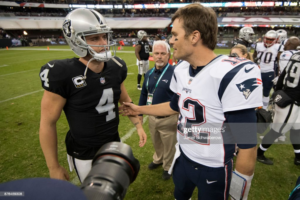 Tom Brady #12 of the New England Patriots and Derek Carr #4 of the Oakland Raiders shake hands after the game at Estadio Azteca on November 19, 2017 in Mexico City, Mexico.