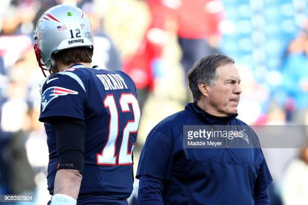 Tom Brady of the New England Patriots and head coach Bill Belichick look on during warm ups before the AFC Championship Game against the Jacksonville...