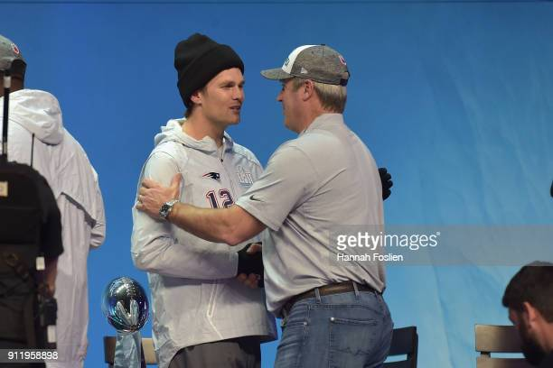Tom Brady of the New England Patriots and head coach Doug Pederson of the Philadelphia Eagles shake hands during Super Bowl Media Day at Xcel Energy...